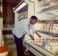 High's---Lawrence Harris stocking the dairy case..jpg