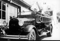 Fire - 1930 AA Ford in front of fire house.jpg