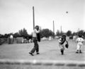 Frederick catcher scrambles after a passed ball 1955.jpg
