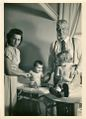 Dr. Thomas Carpenter with a nurse and children..jpg