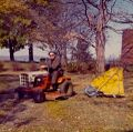 Pet Lloyd mowing his lawn on a Fall day at his Rosemont home.jpg