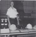 Fire - Firefighter Dave Taulton presiding over a display at the Fire Hall..jpg
