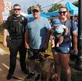 Officer Brandon Smith with Scott Moore, Cally, son Elliott and Gretchen their fur baby.JPG
