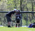 Lacrosse 2018, Coach Bill Williams with Owen O'Connor, May 2018. Photo Heather Bussard.jpg