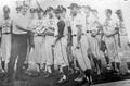 MARVA Babe Ruth Team, Manager Gene Green and Mike Deener accept a tournament trophy.jpg