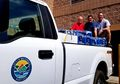Councilmen Wayne Allgaier, Harry Lashley and Vaughn Ripley with bottled water for the community after the water main break, August 6, 2018.jpg