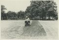 John Graham mowing his grass in Rosemont in the 1960s.jpg