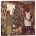 Karen Lipscomb (left) and Mrs. Kathleen Lipscomb with their Christmas tree 1970s.jpg