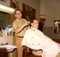Ken Harshman barbering at the YMCA in the early '70s.jpg