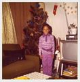 Michelle Lipscomb posing in front of her tree.jpg