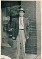 Lee Smith, Sr. on the steps of Kaplon's in the 1950s.jpg
