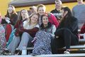 Alex Bruchey in pink, Carley Myers on the left, Hailey Cordero on the right, Brunswick High School baseball game 2018.jpg