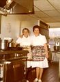 Rex Merriman with Mildred Himes, head cook of the YMCA kitchen.jpg